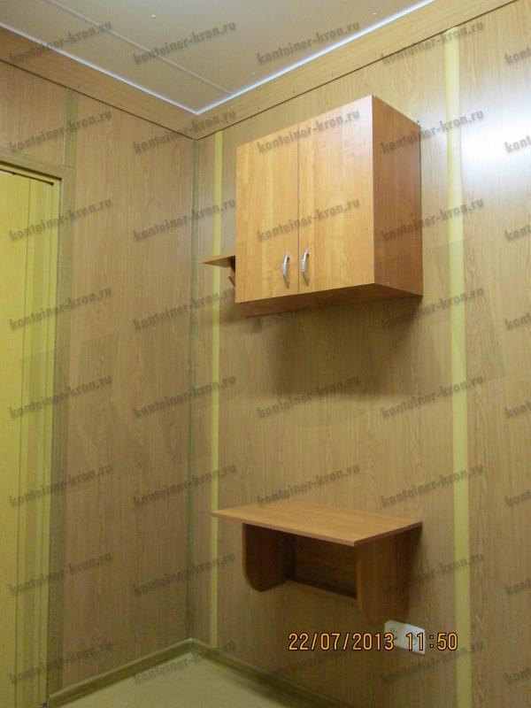 Фотография раскладного обеденного стола установленного в МКПП в комнате отдыха