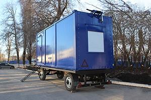 Фото металлического контейнера на шасси вид сбоку